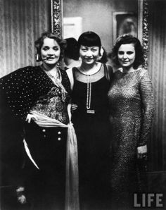 Actresses Marlene Dietrich and Anna May Wong with filmmaker Leni Riefenstahl at Pierre Ball. Berlin, 1928  Photograph by Alfred Eisenstaedt.