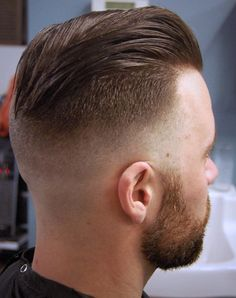 Under cut with shaved bottom and very little graduation to next section and no graduation between side and top