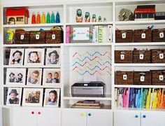 Great combination of numbered baskets and storage covered with photos.