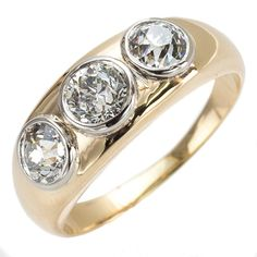 Smooth Operator: This ring is all about soft flow, until you get to the brilliant sparkle of the three old European cut diamonds. Platinum bezels smoothly hold the stones low in a thick sculpted band of yellow gold for a lush, low profile ring that is both spectacular and practical. Ca. 1900. Maloys.com