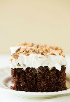 A chocolate poke cake infused with sweetened condensed milk and caramel sauce, then topped with Cool Whip and toffee bits.