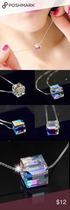 BEYOND GORGEOUS CUBE NECKLACE!! ✔️✨ Shimmering from every angle with beautiful hues of crystal blue, pink, gold and clear!  The colors of the rainbow glow through this necklace!! You'll love it ✔️✨ Jewelry Necklaces