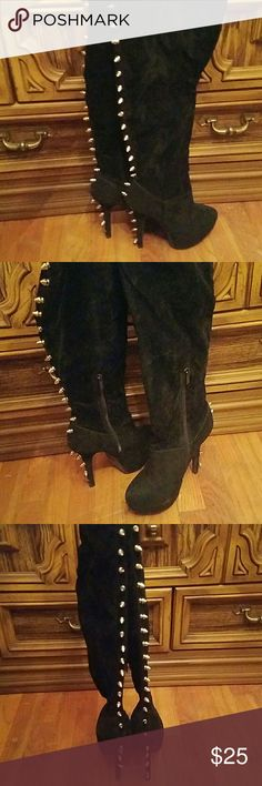 SOLD!!! Thigh high spiked black boots SOLD!! Bad a$$ sexy pair of thigh high spiked high heeled boots! They are a velvet material with spikes going down the back. On the left there are 2 spikes missing, on the right there is one missing, but it's not very noticeable. I bought these from another posher who wore them twice and I only wore them once because the heels are a little too high for me. Unknown  Shoes Over the Knee Boots