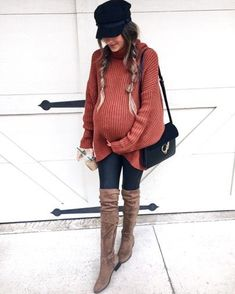 I like this pregnancy look, oversized sweater with jeans and flat boots