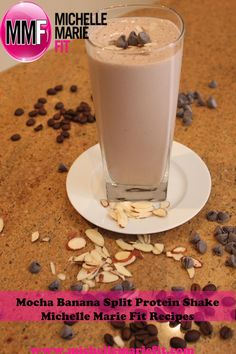 1 cup almond milk 1/4 frozen banana 1/4 tsp instant coffee 1 scoop chocolate protein powder sprinkle of sliced almonds