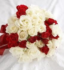 Red and White Roses arranged to make a simple but elegant bouquet.