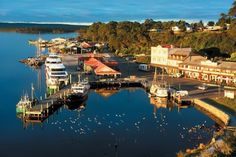 Six of the best: Charming Tasmanian townships. Traveller Magazine gives the goss on six small locations here. Did you know that Strahan sits on the shores of Macquarie Harbour - a whole six times larger than Sydney Harbour! Image credit: Dan Fellow and Tourism Tasmania's Visual Library.