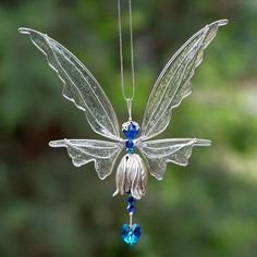 Fairy Suncatcher Small - Birthstones & 24 More Swarovski Colors - Silver or gold toned Fairy Add a little fairy magic to your windows!Arts And Crafts Wallpaper ProductThis item is unavailable Art Plastic, Plastic Bottle Crafts, Plastic Bottles, Beaded Ornament Covers, Beaded Ornaments, Mythological Creatures, Wire Crafts, Fairy Houses, Wire Art