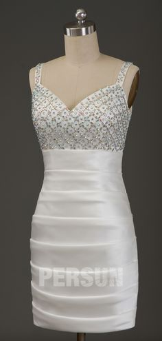 Fall in love with this beaded bodice & column cut. Never let yourself go another place to find this gorgeous ivory cocktail dress for your party.