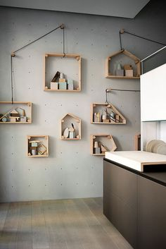 ***maybe paint a giant pegboard? How fun is this display? You can then move the pegs and shelves......