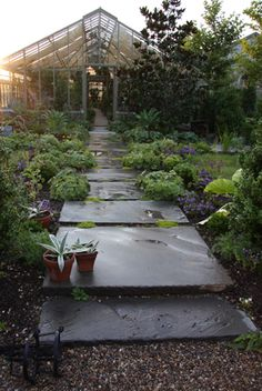 Very nice large stone pavers leading to the Greenhouse | AJF Design