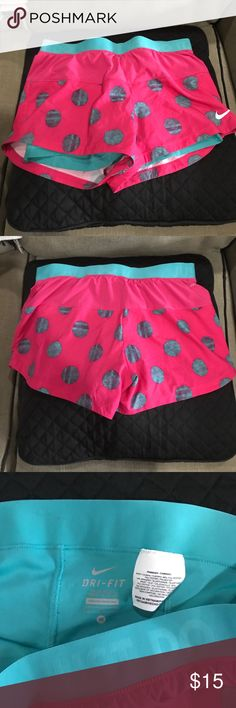 Like 🆕, Nike Dri Fit Shorts, Size M Cute Pink and turquoise polka dotted Nike shorts with built in compression shorts. In excellent condition! Size Medium. Who says you can't be cute while sweating?! Nike Shorts