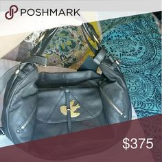 """Flash Sale!!! Marc Jacobs Petal to the Metal Mevie Guaranteed authentic New with Tags """"Petal to the Metal"""" Mevie Hobo bag in the color Newsprint (dark grey with green and blue undertones) with brass hardware. The Petal to the Metal line has been discontinued and is a highly sought after classic Marc by Marc Jacobs line.  Has a long crossbody strap as well as a shorter shoulder, hand or arm carry strap. Retail price is $498. Comes with original dustbag.   Listed for $175 on Merc.   Thanks for…"""