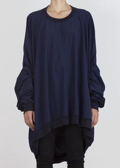 Long sleeves and a generous draped hood. Made of lightweight technical fabric. Soft ribbed collar, cuffs and hem. One size fits most. Model is tall. Women Wear, Tunic Tops, Unisex, Hoodies, Long Sleeve, Fabric, Sleeves, Model, Cuffs