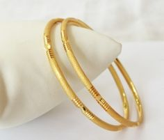 Set of two finely gold plated bangles. Avoid direct contact with water and perfume. Always keep in poly bags after Plain Gold Bangles, Gold Bangles Design, Gold Plated Bangles, Gold Jewellery Design, Indian Gold Bangles, Handmade Jewellery, Gold Armband, Gold Jewelry Simple, Sterling Silver Bracelets