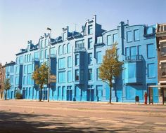 Beukelsblauw  Rotterdam 2004-2006  115 x 15 meters  Latex emulsion paint    This was once one of the most unseen blocks of houses in Rotterdam, and by applying a layer of only 2 micron of blue paint onto it, it became Rotterdam's most photographed one. By redecorating this block, which was built in the first years of the 20th century, people start looking again at what was and is there, and maybe think about what they will get in return.
