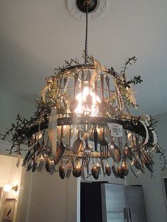 Old Lampshade turned Chandelier w/spoons