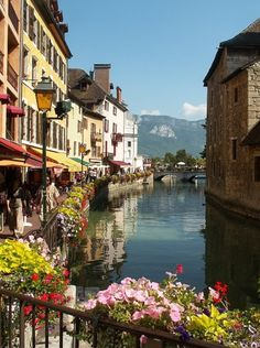 Beautiful Annecy, France.  The lovely French language and scenery would be amazing to see in person!