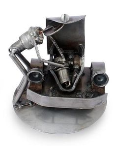 Recycled Auto Parts Sculpture Metal Art Mexico - Rustic Car Mechanic. Spark plugs are recycled into an expressive sculpture by Mexican artisan Armando Ramirez. He portrays a mechanic at work on the front part of a V.W. Beetle, which he crafts from a car's ball bearings, chain and rocker arm. | NOVICA was 71 dollars now $39.99 Hand Crafted!