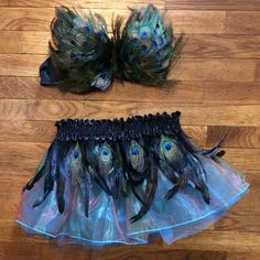 Handmade peacock costume! Handmade and never worn. The bra was a bit too big for me would fit a B/C cup nicely! Real peacock feathers, strapless bra, elastic tutu, and feathered belt to accent tutu. This costume is truly a show stopper! Intimates & Sleepwear Bras