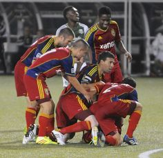 Real Salt Lake players celebrate their equalizing goal in stoppage time in the second half of an MLS Soccer game against the Portland Timbers in Portland, Ore., Wednesday Aug. 21, 2013. (AP Photo/Greg Wahl-Stephens) | The Salt Lake Tribune