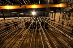 This photo was taken backstage at the historic Ohio Theater in Playhouse Square. These ropes are stretching toward a light at the top of the theater. The ropes control some of the curtains and effects in the theater.