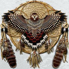 Amazingly detailed quadruple dream catcher, assuming art work made by a Native American. Red tail hawk feathers & and an eagle made out of beads.