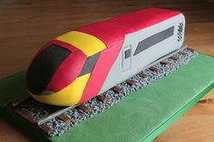 A Birthday cake for a friends son. A large fruit cake split in half and then stuck together end to end to give a long cake. Although not a total copy I used this train as a source for the design and colour scheme. Kids Cooking Recipes, Cooking With Kids, Fondant Cakes, Cupcake Cakes, 3d Cakes, Cooking Roast Beef, Cooking Broccoli, Cooking Turkey, Adult Party Themes