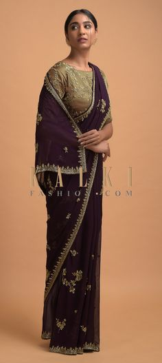 Buy Online from the link below. We ship worldwide (Free Shipping over US$100)  Click Anywhere to Tag Raisin Purple Saree In Georgette With Cut Dana And Sequins Embellished Floral Motifs Online - Kalki Fashion Raisin purple saree in georgette adorned with cut dana and sequins embroidered floral motifs in repeat pattern.Paired with a dark gold blouse in satin with floral embroidery. Gold Blouse, Floral Blouse, Purple Saree, Saree Look, Latest Sarees, Georgette Sarees, Floral Motif, Raisin, Floral Embroidery