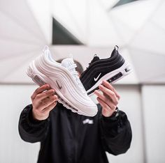 Black and pink Nike Air Max 97 shoes.