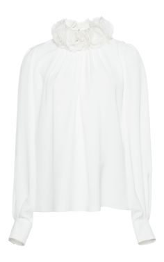 Rendered in silk, this **Andrew Gn** blouse features a high ruffled neck, full length sleeves, and a relaxed fit.