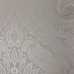 Khitan Wallpaper  An opulent paisley damask wallpaper printed in a reflective silver on a white background.