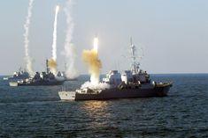enrique262:  Arleigh Burke-class destroyers and a Ticonderoga-class cruiser firingRIM-66 Standard missiles.