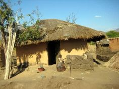 Little child in front of his Malawi mud hut home Vernacular Architecture, Architecture Design, Mud Hut, I Want To Travel, Sticks, Countries, Grass, Globe, Places To Go
