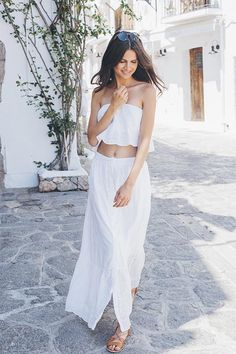 Sometimes simple is the most effective. The Gypset Maxi skirt is a white maxi with button-down detail from waist to hem. The skirt is lined but covered in a feminine leaf-schiffli detail. From below the knee, the skirt has an added frill to create the most fluid movement when worn.