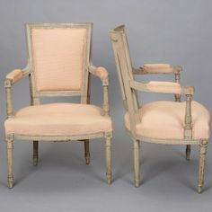 """Pair Circa 1900 Louis XVI Style Armchairs  --  Turn of the century French armchairs with class Louis XVI styled frames featuring decorative carved details on legs, arms and seat backs. New upholstery in pale apricot with subtle ribbed surface texture. Seat backs have coordinating striped fabric. Arms are 25.5"""" high. Seats are 17.5"""" deep and 16.5"""" tall. Sold and priced as a pair.  --   Item:  4939  --  Retail Price:   $2495"""