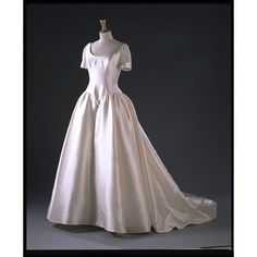 Style W9737  Object: Wedding dress  Place of origin: England, Great Britain (made)  Italy (silk zibeline fabric, woven)  China (silk organza fabric, woven)  Date: 1996 (made)  Artist/Maker: Lepley, Phillipa, born 1965 (designer)