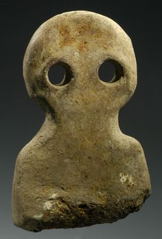 SYRIAN LARGE TERRACOTTA EYE IDOL. Both the type and the large size are rare. 4th Millennium BC.   H. 7 1/2 in. (19 cm.). Ex German private collection.