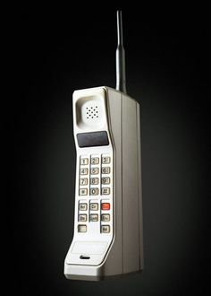 The first mobile phone.  Analog Motorola DynaTAC 8000X Advanced Mobile Phone System mobile phone as of 1983. Had this in the car in 1997 when Devon and I broke down ;-)