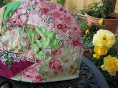 To see the whole journey of the Tea Cozy Click Here Here it is out in my garden!!! AND you can see my spring roses blooming! It has take...