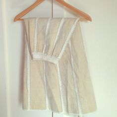 Cream Crochet Suede Leather Maxi Skirt Beautiful and feminine, this maxi skirt is pieced together from flared panels of soft, beige suede. Zipper in back and crochet stitching along panels, hem, and waist. Skirts Maxi