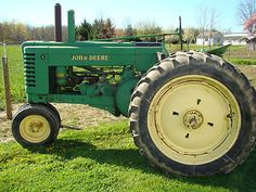 Antique John Deere Tractor~ My Great Grandpa Hoffman has one just like this!!John Deere Styled Model A