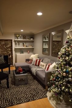 Red and White accessories add a traditional Christmas feel in this basement, while the mixed patterns create a modern feel. HomeGoods Sponsored Pin.