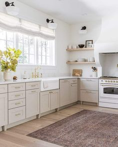 With plenty of room for the kids to play this kitchen is the heart of the home. Featuring the Nostalgie Series Cooker in Bright White and Brass and paired with a feature rug this space is a dream for cooking enthusiasts. Classic Kitchen, New Kitchen, Kitchen Decor, Taupe Kitchen, Kitchen Furniture, Home Design, Küchen Design, Home Interior, Interior Design