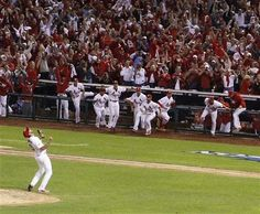 starting pitcher Adam Wainwright celebrates his complete game victory as teammates rush the field after Game 5 of the NLDS.  10-09-13