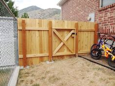 We needed to keep Darla the basset hound in our yard, so I built this simple but handsome fence.