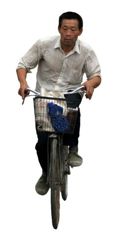 Chinese man riding bicycle Source: Flickr-Ernop/CC-Attribution