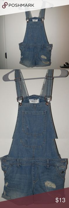 Forever 21 women's overalls Brand new Forever 21 overalls. Tag attached! (see pics) Cute short style, brand new condition (tearing done by manufacturer). Bought for a 90s themed costume party and ended up wearing something else. Held onto past return date. Forever 21 Jeans Overalls