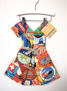 "Around the World paper ""dress"" made from vintage travel paper by Marcelle Crosby. Beautiful!"