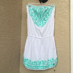 Cynthia Rowley swimsuit coverup Cynthia Rowley swimsuit coverup. White with turquoise embroidery and subtle gold sequins. Strapless, ties at the waist. In great condition. Cynthia Rowley Swim Coverups